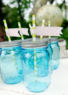 blue mason jar drinks with paper straws. Love the colors she used!