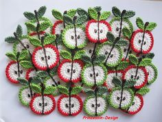 Apples  crochet  -- appliques for clothes pins or maybe magnets...