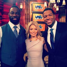 Kelly and co-host Michael Strahan with Superbowl champ Justin Tuck, #91 on the Giants!