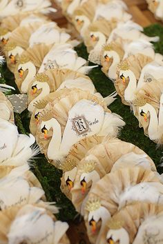 Paper Swans from Once Upon A Dream art event. Great escort card idea?