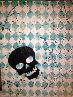 A 14x16 canvas painted with a gradient quatrefoil pattern, a black skull, then splattered with hot wax in various colors.