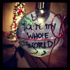 """""""But you're my whole world."""" (This is the back of the ornament I made Cayden. Notice my continent placement is way off)"""