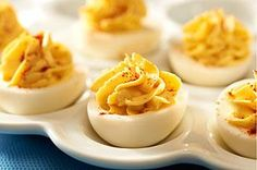Easy Deviled Eggs recipe - It's the Dijon mustard that puts the devil in these deviled eggs. Its spicy zip is softened with Miracle Whip Dressing for a tangy kick in every bite.
