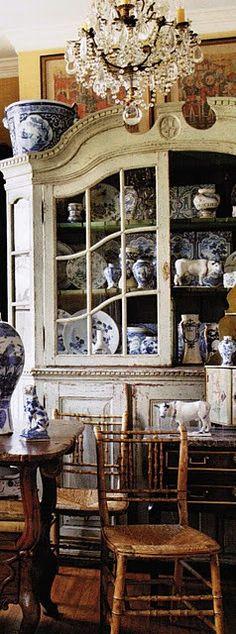 Blue and white transferware in a cupboard