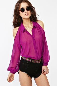 Idea!!! Take an old collared shirt and sex it up by cutting out the shoulders of it and there you have it, a new shirt.