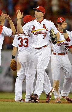 Matt Holliday high fives teammates after defeating the Cincinnati Reds.  4-30-13
