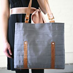 A sophisticated yet functional bag. Ingeniously crafted from Petersham ribbon. Made by Nelle Handbags. Expensive? At $160.00 you decide. I'd like one, please.