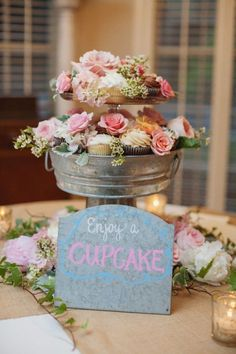 Garden-themed wedding cupcakes in a rustic display #wedding #gardenparty #cupcakes #weddingcupcakes #cupcaketower