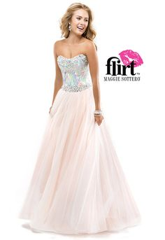 Your partner in shine is found in this glittering ball gown! Make a statement with a fully jeweled bodice complete with stacked beading at the neckline and waist and paired with a full tulle skirt. #flirtprom #blush #pink #promdress