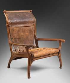 Eugéne Gaillard (1862-1933) - Side Chair. Carved Wood with Leather Seat and Back. Circa 1907.