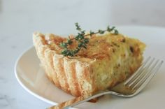 Recipe for Quiche Aux Poireaux. Made with leeks, gruyere, and goat cheese.