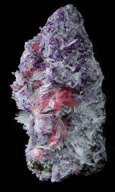bijoux-et-mineraux:  Rhodochrosite with Fluorite & Quartz with Minor Pyrite and Hübnerite - Sweet Home Mine, Alma, Colorado