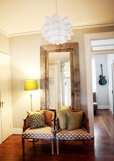 Wood pallets and mirrored closet doors to make huge mirrors--gorgeous!