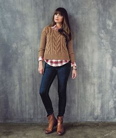 Mixing a plaid shirt and a chunky cable sweater creates the perfect casual weekend look.