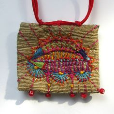 Hand Embroidered Multi-Colored Necklace with Red Cord. $45.00, via Etsy.