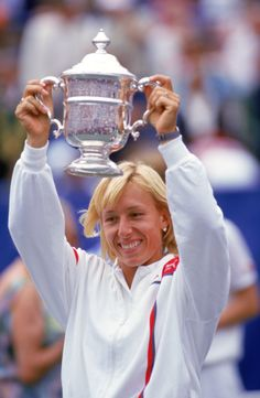 Martina Navratilova hoists her trophy as she celebrates winning the Women's U.S. Open title in August of 1986. (Photo by Trevor Jones/Getty Images)