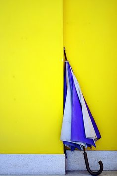 An old Umbrella on a Yellow Wall in Cochin