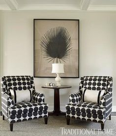 Custom Ken Gemes club chairs upholstered in stylish bold dots punctuate the living room. - Traditional Home ® / Photo: Tria Giovan / Design: Ken Gemes