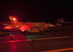 PHILIPPINE SEA (Sep. 26, 2013) An  F/A-18E Super Hornet from the Eagles of Strike Fighter Squadron (VFA) 115 prepares to launch from the flight deck of the aircraft carrier USS George Washington (CVN) 73 during night flight operations.
