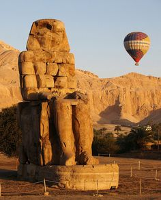 Hot air balloon above Valley of the Kings, Egypt (by SteveInLeighton). (with bonus Colossi of Memnon!) Been there, done that :)