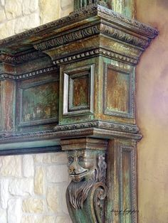 Oxidized finish on a fireplace mantel with Metal Effects products   By Broads with Brushes