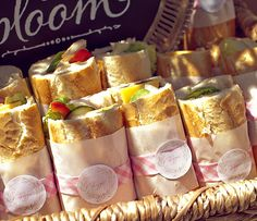 french baby shower veggie sandwiches. love the fancy wrap on these