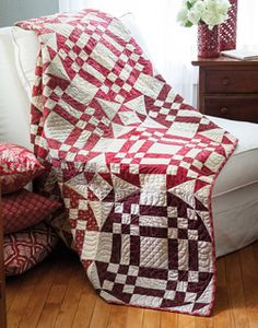 Will you Walk Into My Parlor? is a throw size quilt pattern featuring tan and red two color quilt fabrics. Designer Tony Jacobson wove a spider's web that's not to be denied. A handy tool, cutting diagrams, and strip-pieced nine patches make sure you will not get stuck. Machine quilted by Kelly Van Vliet.