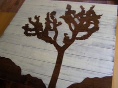 Left over wood flooring turned into wall art with paint and projector for image.