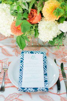 colorful place setting, photo by Troy Grover Photographers http://ruffledblog.com/colorful-wedding-at-hotel-ballard #patterns #weddingideas