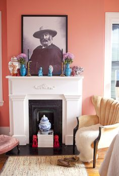 Awestruck at the masterful mix of styles here -- foo dogs, old American photography, classic architecture, preppy wallpaper, a sheepskin throw...!