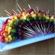 Rainbow fruit skewers.  I like the presentation.