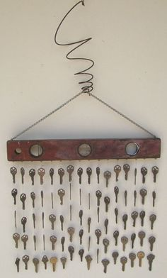 Key wind chimes with old woodworking level