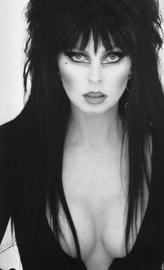 'Elvira'  just look at her...a picture is worth over a thousand words..she  defined her era, as the Mistress of the Dark! ~*~moonmistgirl~*~