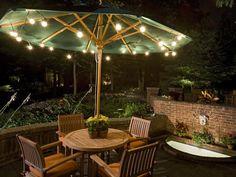 Good lighting idea.  Festive too. patio lighting, decorating ideas, backyard lighting, umbrella, lighting ideas, landscape lighting, patio tables, garden, party lights