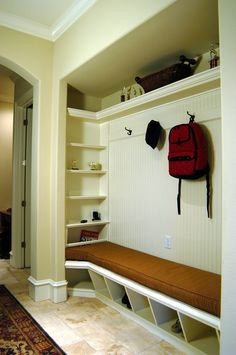 Families certainly know that entries to home can get messy, but the best way to stay organized is with a bead board wall complete with hanging hooks, an entry bench and a coat closet remodel. Now all you have to do is make sure your children take advantage of this remodeled entry way.