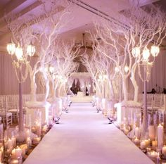 We can't get over how gorgeous this dramatic winter wedding aisle is! #weddings #winterwedding #weddingdecor