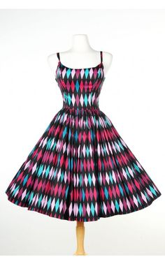 Pinup Couture- Jenny Dress in Turquoise and Black Harlequin Print | Pinup Girl Clothing