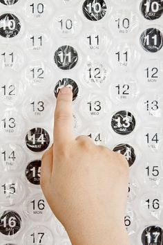 The 2012 Bubble Calendar is a fabulous 4-foot tall poster-sized bubble wrap calendar that you pop as the days go by.