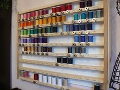 DIY - Great idea for organizing thread... better than the average spool rack because it has coordinating bobbin storage too!  (for now, slide matching bobbins under spools)