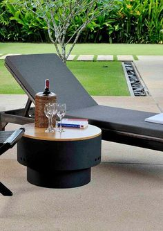 This fire pit (yes, that's a fire pit) comes with a wooden top to make it a side table by day. It comes with a grill included, too!