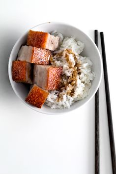 Cantonese-style roast pork belly on rice with sweet soy sauce.