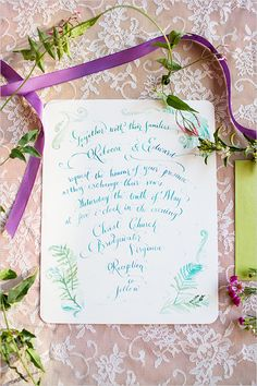 white and turquoise wedding invites
