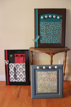 Jewelry display boards made from repurposed kitchen cabinet doors and pulls.