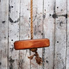 This rustic tree swing is sure to take you back to a simpler time. Made of reclaimed old-growth pine and natural fiber rope strong enough to withstand 695 pounds of tension, it's ready to hang right away and sturdy enough for years of use.
