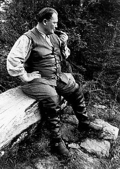 9-6-1938 - Hermann Goering Smoking a Pipe on a Log - Stock Photo - Corbis
