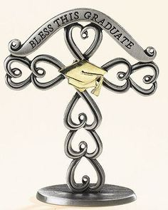 Graduation Standing Cross Gift Boxed Brass-plated Base Metal 3 Inches Wide X 3.75 Inches High by Gifts of Faith, http://www.amazon.com/dp/B003BTQHYU/ref=cm_sw_r_pi_dp_x2XDpb1S14PG2