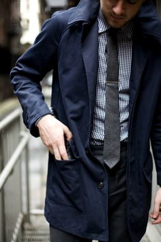 navy trench, navy gingham shirt, grey tie and charcoal pants.