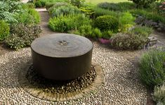 An attractive and child-friendly water feature in this contemporary Buckinghamshire garden by Acres Wild. www.acreswild.com
