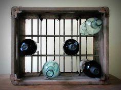 vintage milk crate repurposed into a wine rack