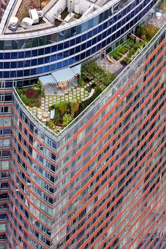 "Lushly planted and furnished penthouse on the roof terrace, designed by Cesar Pelli Building Visionaire in Battery City, ""The Visionaire, 70 Little West Street, Battery Park City, Manhattan"""